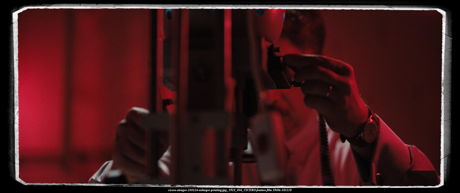 CICERO-the bad guy is printing fotos in his professional laboratory