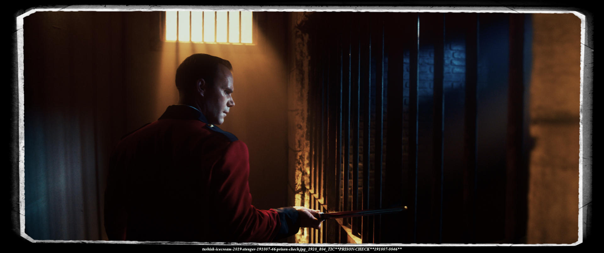 captain Wayne is checking the inmates of his prison at night