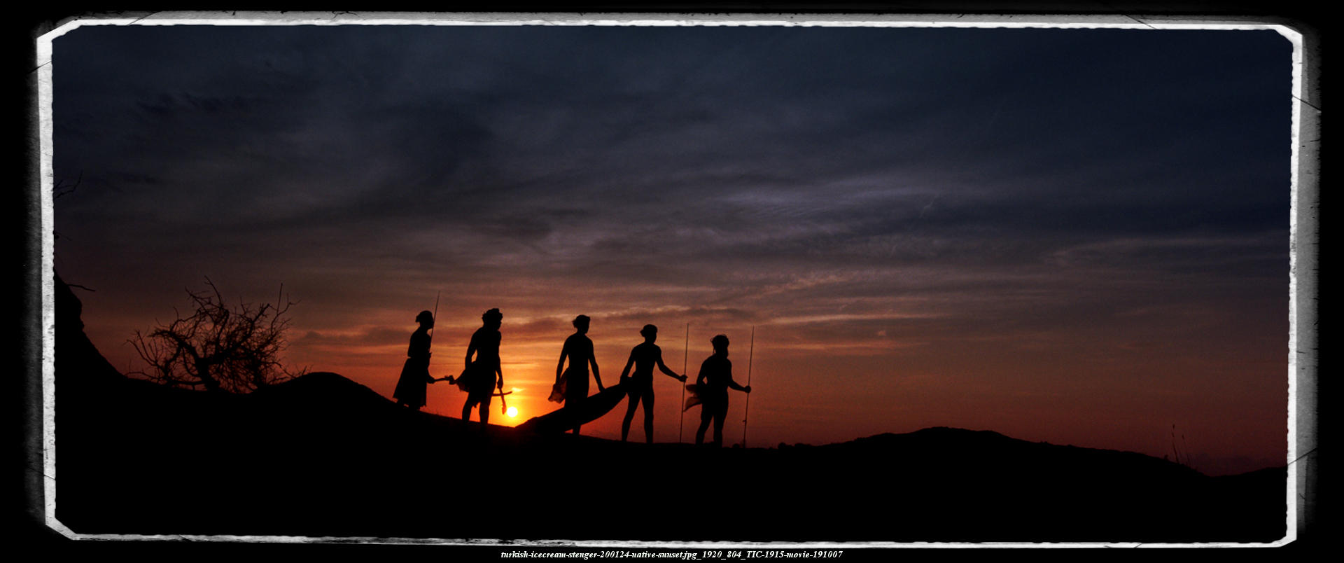 turkish-ICECREAM-silhouettes of a group of aborigines standing on a hill, facing the golden sunset